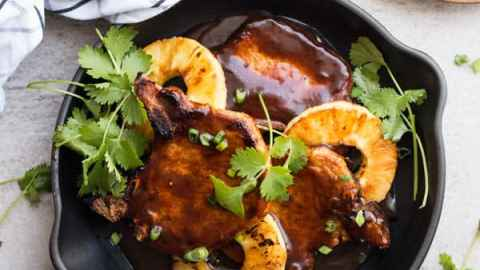 This easy pork chops recipe comes together in just one skillet. They're smothered in a brown sugar BBQ glaze, perfect as a quick weeknight dinner!
