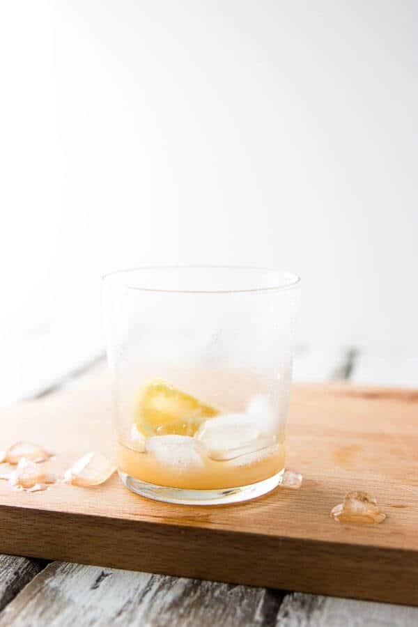 Empty glass of spiced ginger lemonade