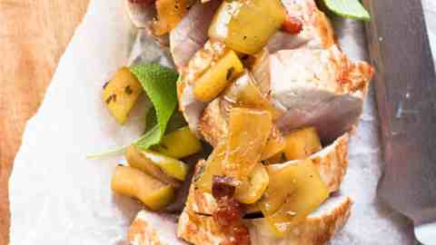 sliced pork loin with apples on parchment