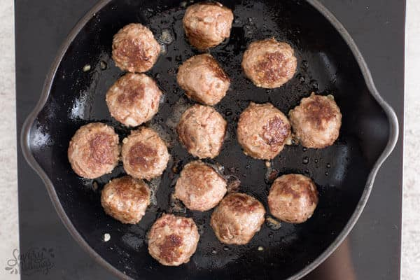 top down view on cooked meatballs in skillet