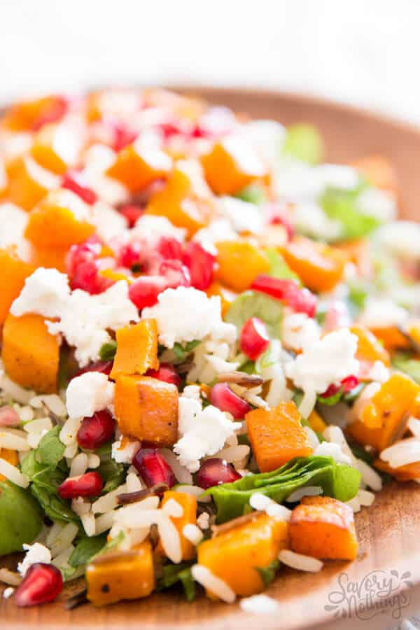 Harvest Wild Rice Salad with roasted pumpkin, pomegranate and feta cheese. The perfect healthy Thanksgiving side dish recipe!