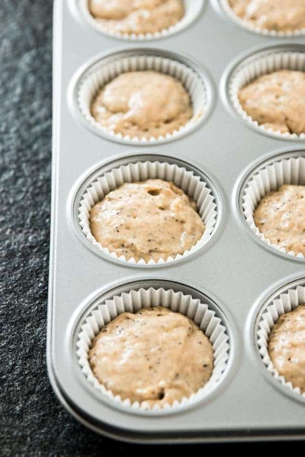 unbaked lemon poppy seed muffin batter in muffin pan