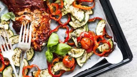 One Sheet Pan Tuscan Baked Salmon and Veggies is an easy weeknight dinner the whole family will enjoy. Just pick a side and you have a healthy meal!