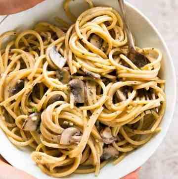 white bowl with mushroom pasta