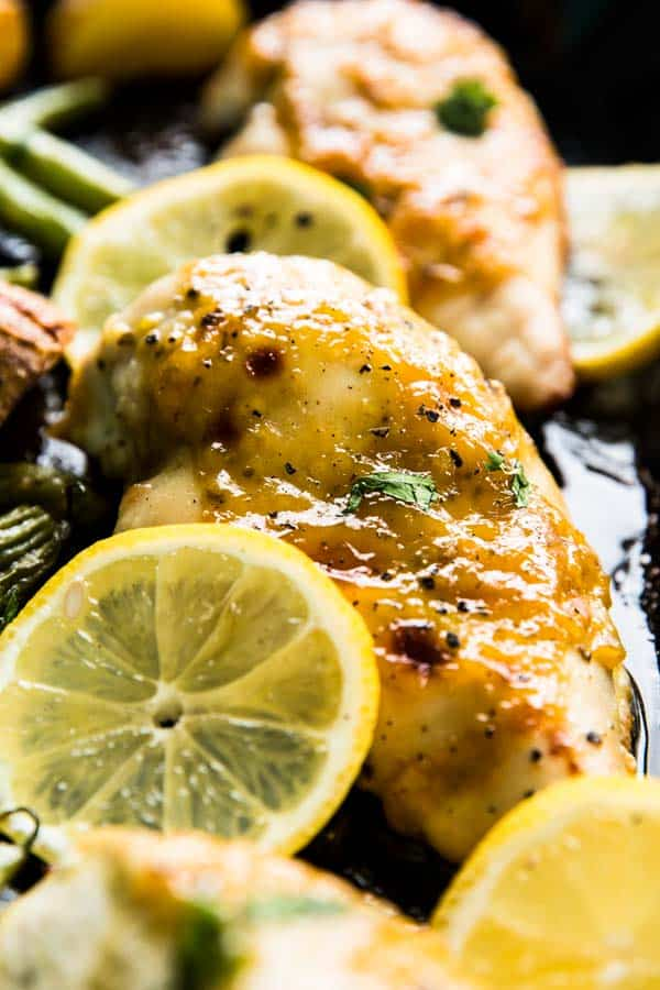 Baked honey garlic chicken is an easy weeknight dinner. Make it on one sheet pan with the side dishes!