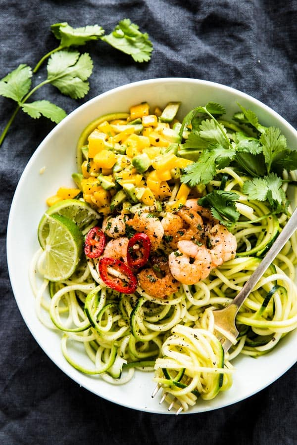 Zucchini Noodles with Cilantro Lime Shrimp and Avocado Mango Salsa: A simple and delicious low carb meal for the whole family! The fruity salsa is SOgood, and 100% kid-approved.