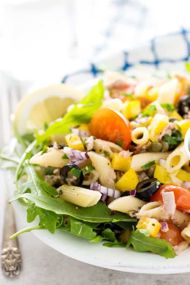 This Mediterranean Tuna Pasta Salad is full of fresh vegetables and delicious summer flavors. A simple homemade dressing makes this the best cold pasta salad recipe you'll ever meet!