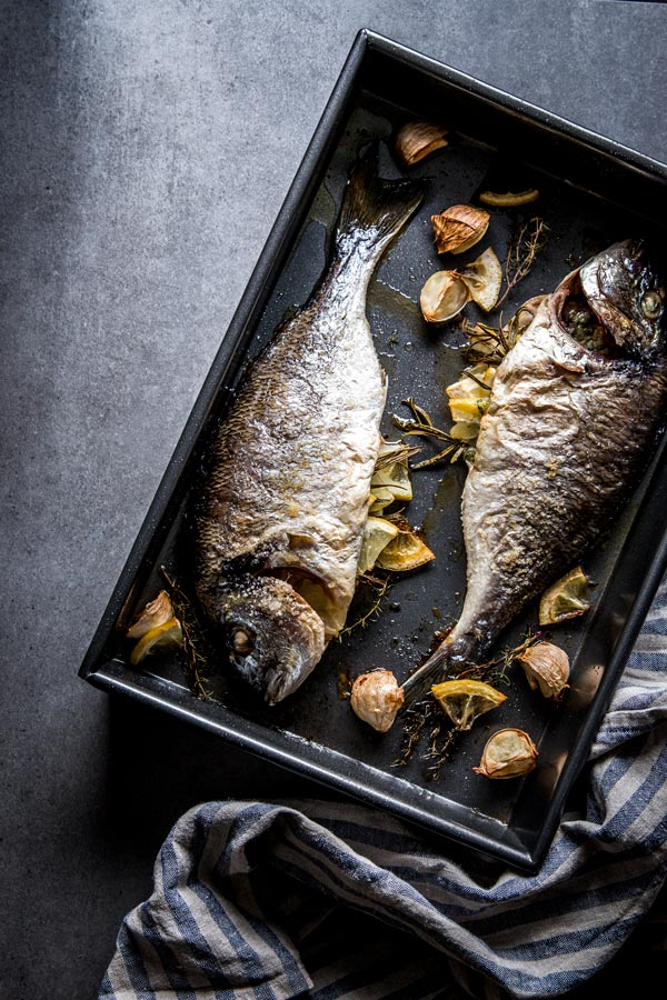 overhead view on baked whole fish fresh out of the oven