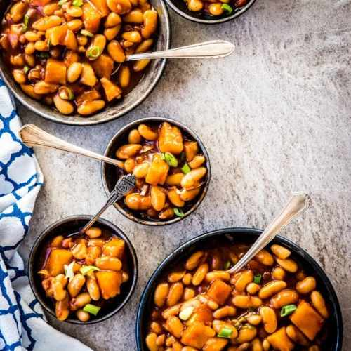 five metal dishes filled with baked beans