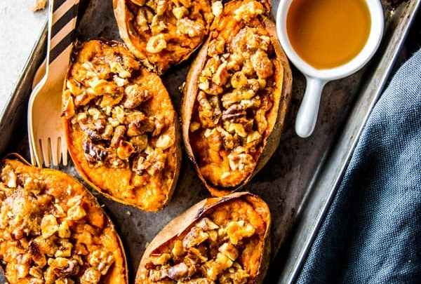 maple walnut twice baked sweet potatoes on a baking pan