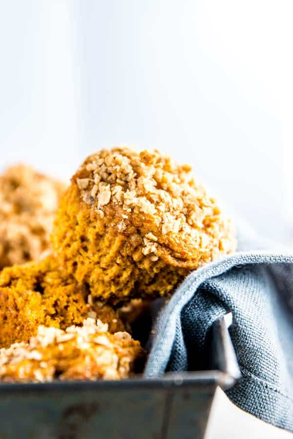 healthy pumpkin muffins in a dish with a dark napkin