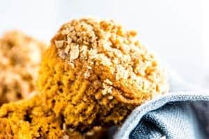 Healthy Pumpkin Muffins in a basket with a dark napkin.