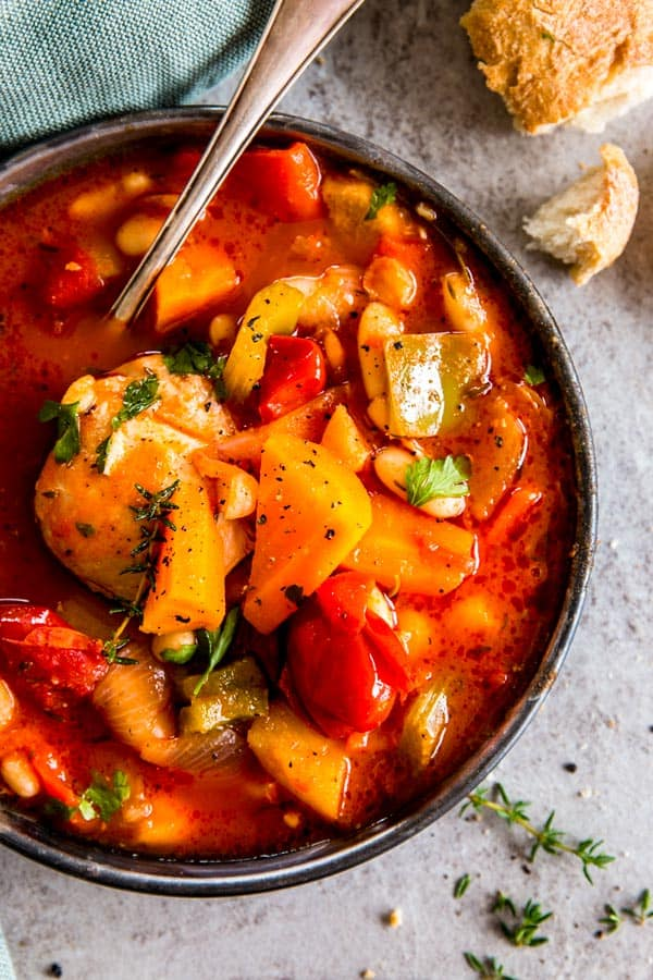 Serve a heart-warming meal out of your slow cooker tonight! This tuscan white bean crock pot chicken stew is sure to please everyone around the dinner table.