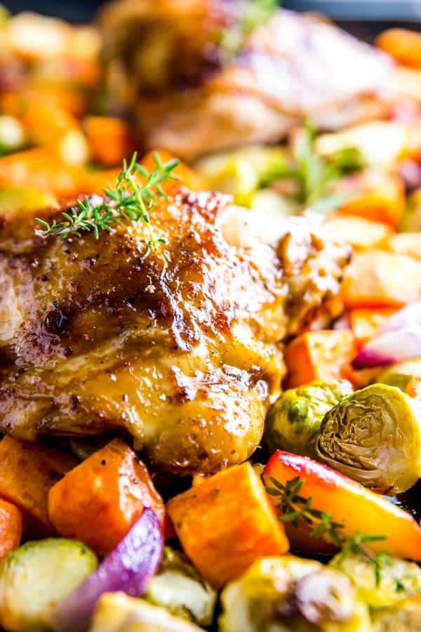 close up of balsamic chicken sitting on vegetables