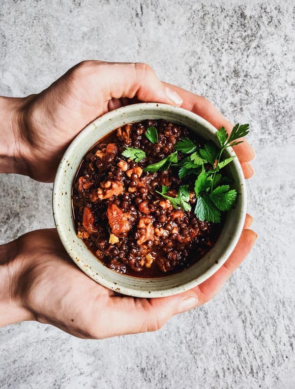 A bowl of hearty walnut lentil filling made in the pressure cooker or instant pot. A healthy vegan main dish!