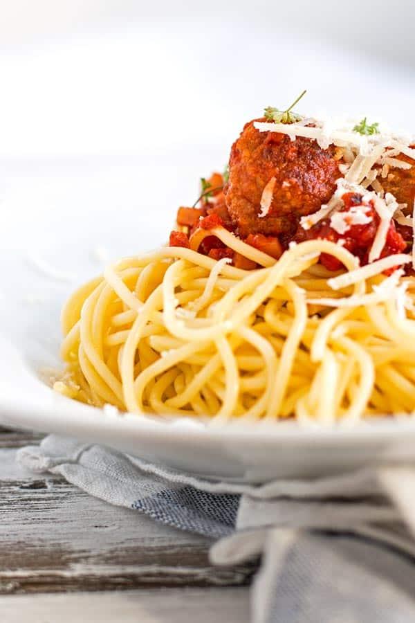 Homemade turkey meatballs in a smokey tomato sauce over spaghetti.