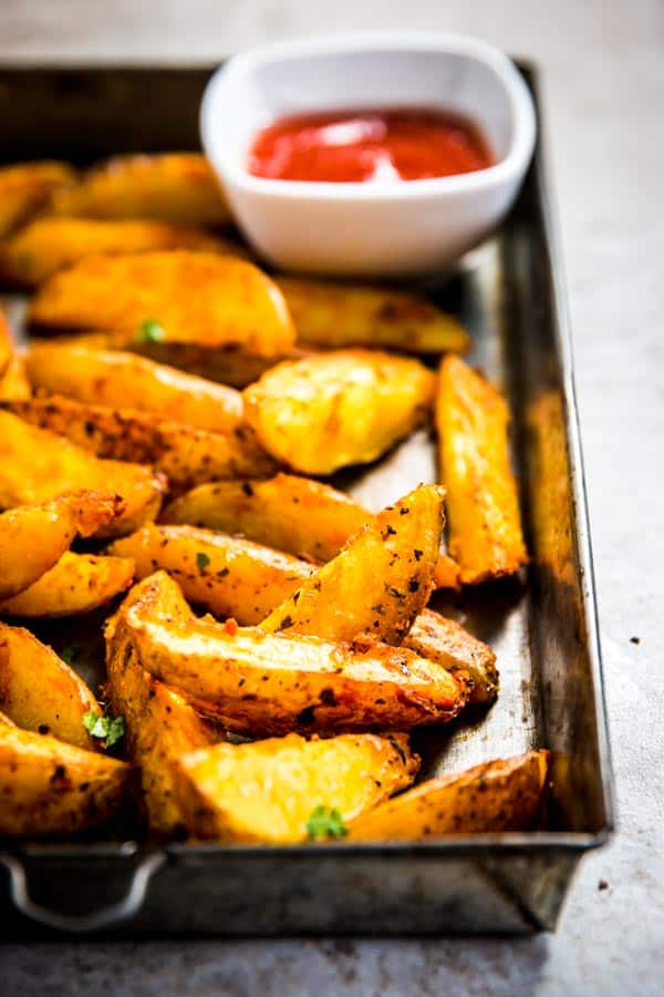 Baked potato wedges on a baking tray