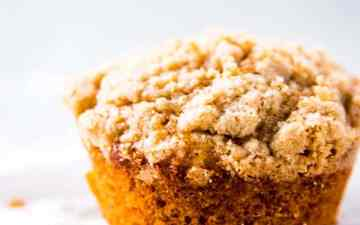 Banana Crumb Muffin on a sheet of parchment paper.