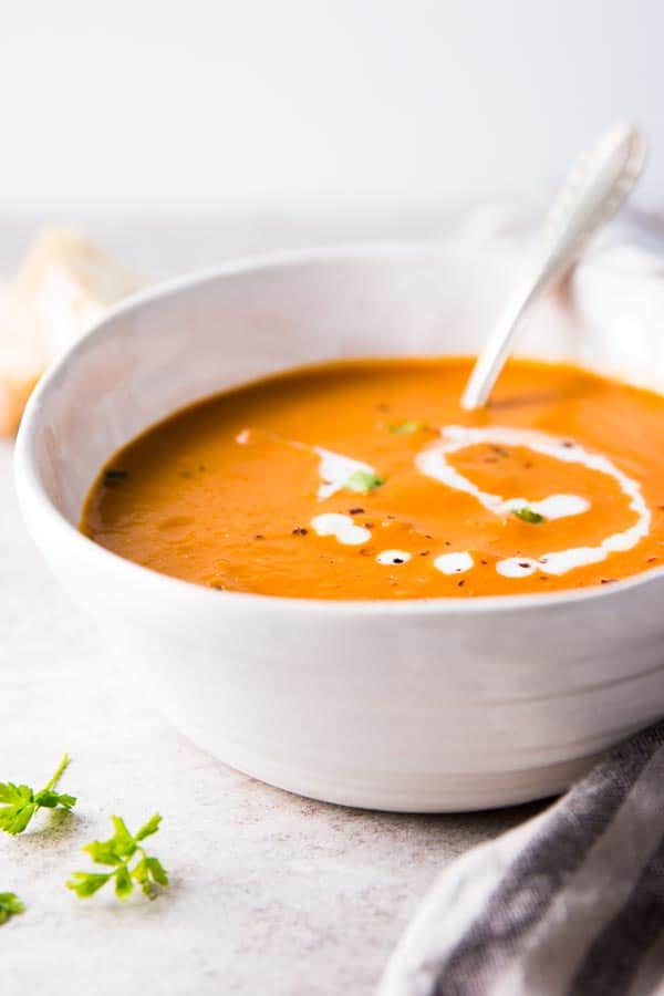 Easy tomato soup in a pottery bowl.