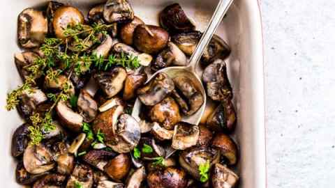 Garlic Butter Mushrooms in a Le Creuset casserole dish.