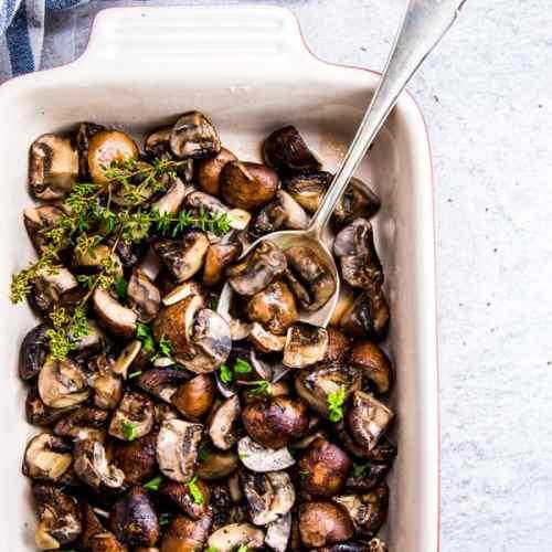 Garlic Butter Mushrooms in a Le Creuset casserole dish.