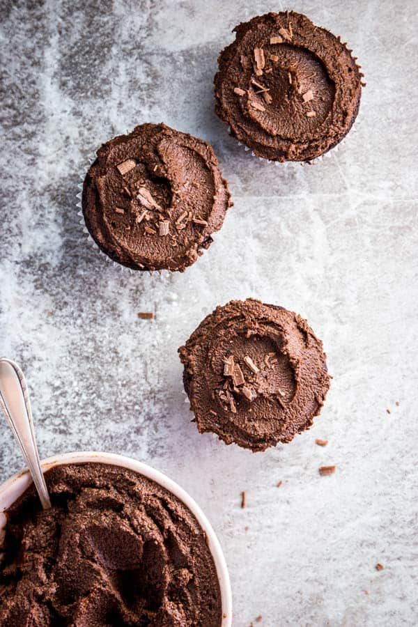 Three chocolate cupcakes, just spread with easy chocolate frosting.