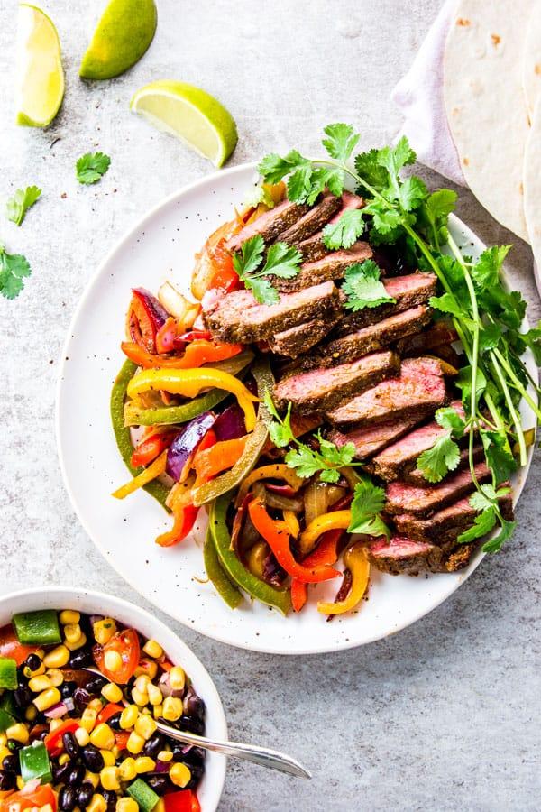 Steak fajitas on a serving platter.