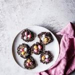 No Bake Bird's Nest Cookies for Easter on a white plate with a pink napkin.