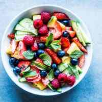 Summer Fruit Salad on a white plate.