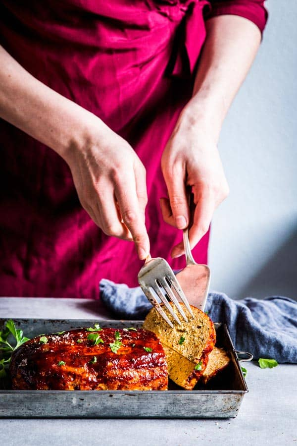Woman in a red dress Erving bbq turkey meatloaf