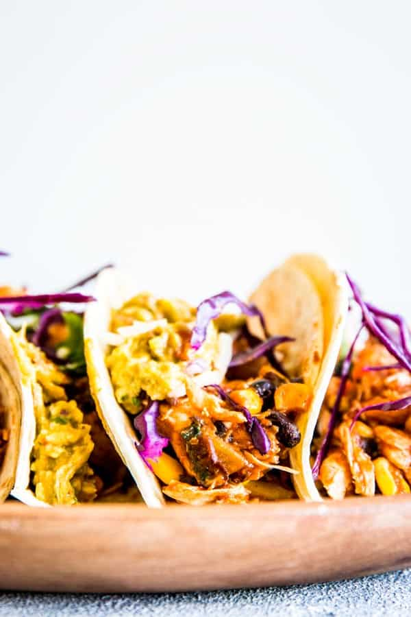 Southwestern crockpot chicken tacos on a plate on the counter