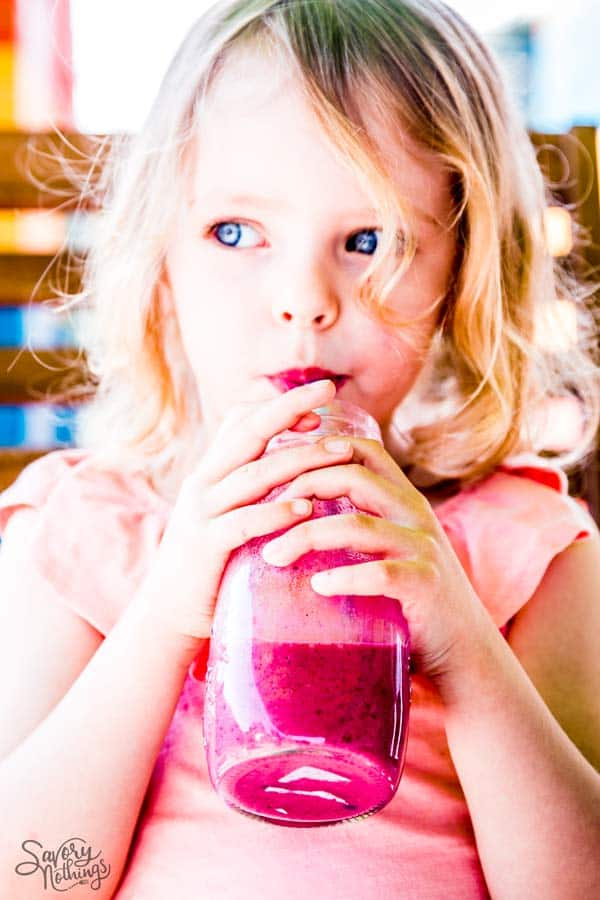 girl with berry smoothie