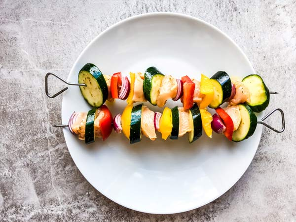 raw greek chicken kabobs, ready for the grill
