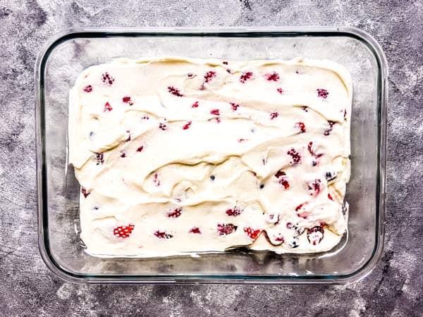 layering a triple berry icebox cake