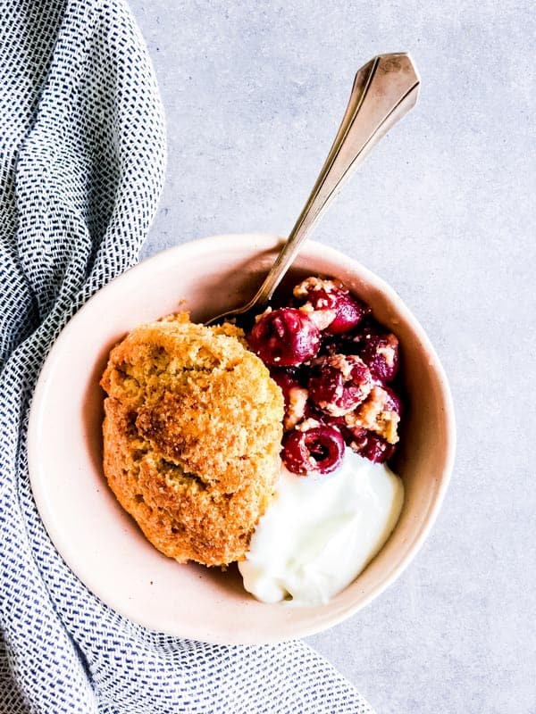fresh cherry cobbler in a small bowl