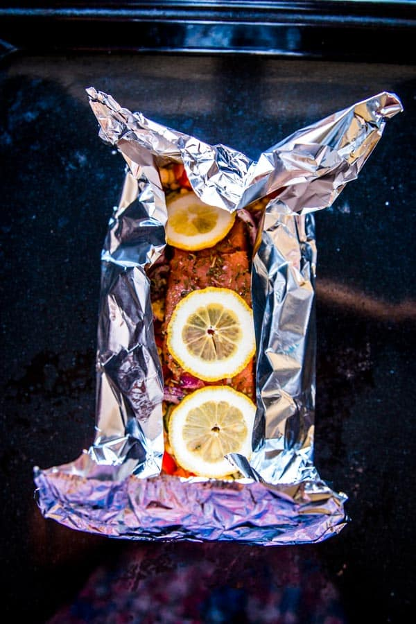 folding a salmon foil packet for the grill