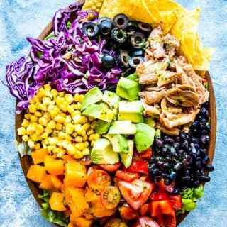 chicken taco salad on a wooden plate