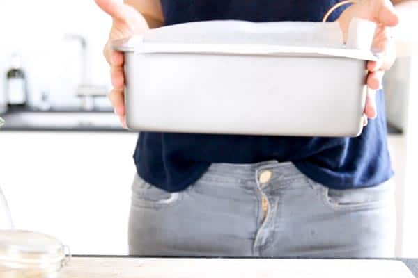 woman holding a loaf pan