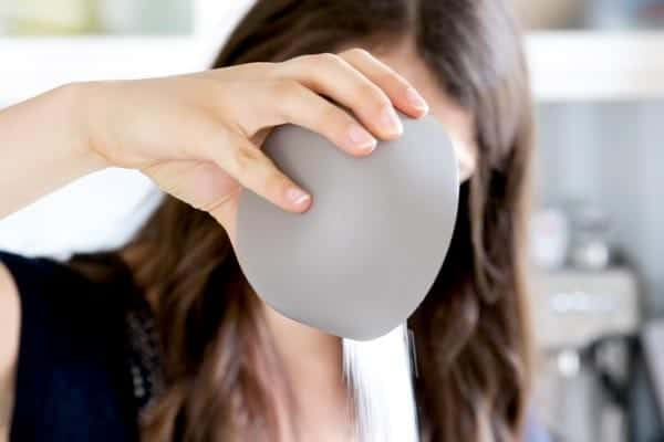 pouring sugar into a bowl