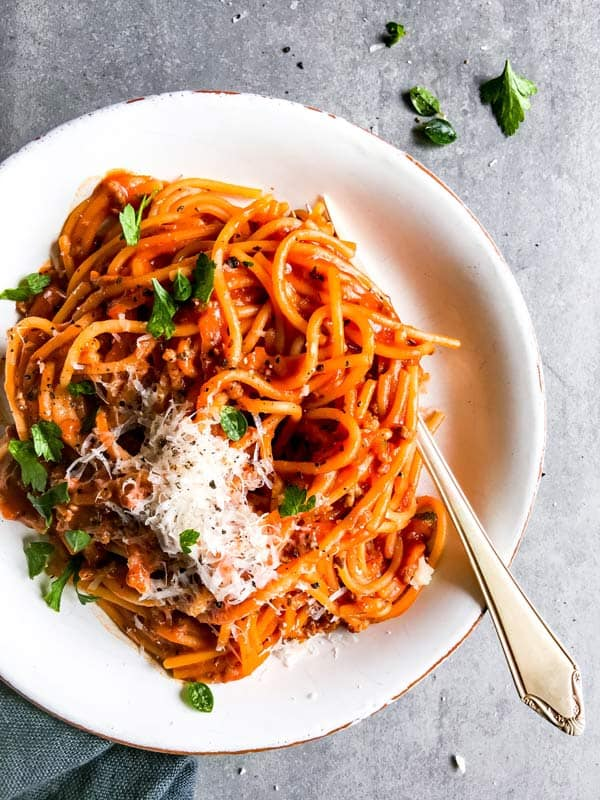 white plate with one pot spaghetti and meat sauce