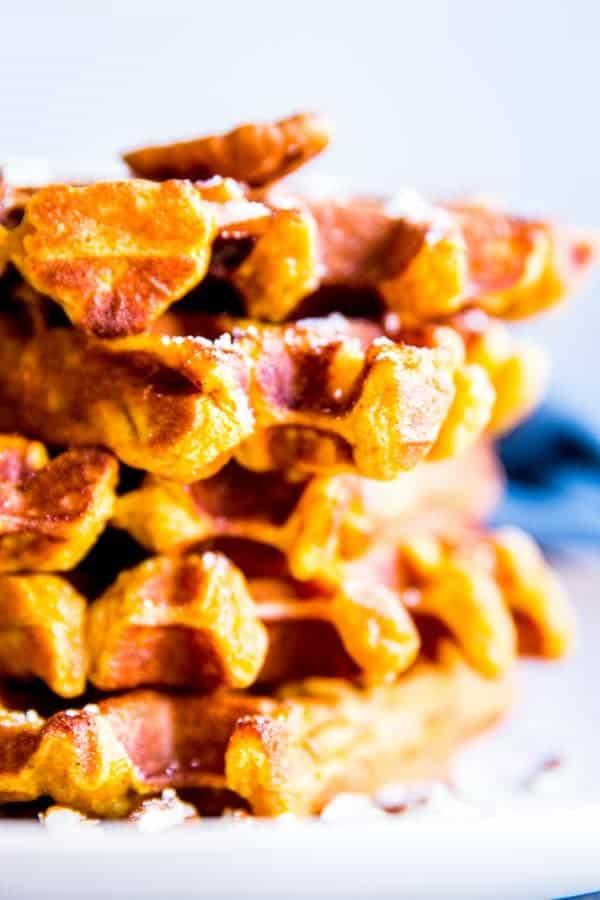close up photo of a stack of pumpkin waffles