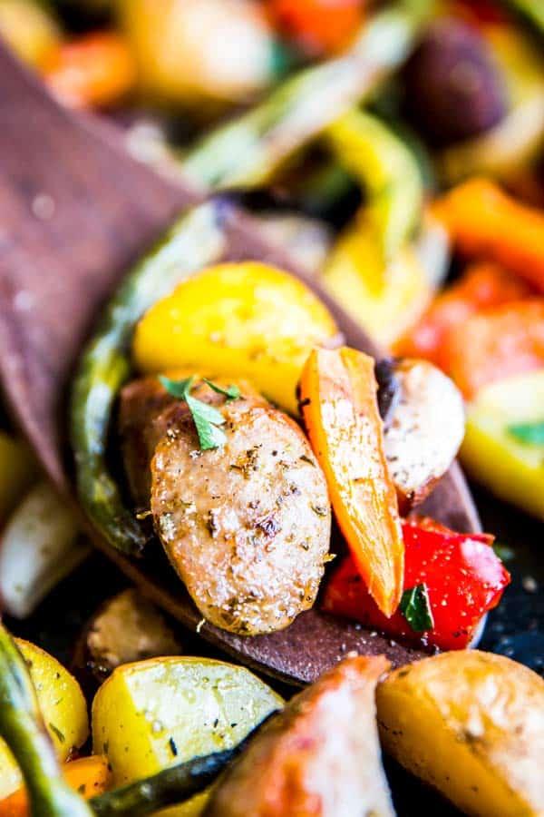 close up photo of sausage potato and vegetables sheet pan dinner