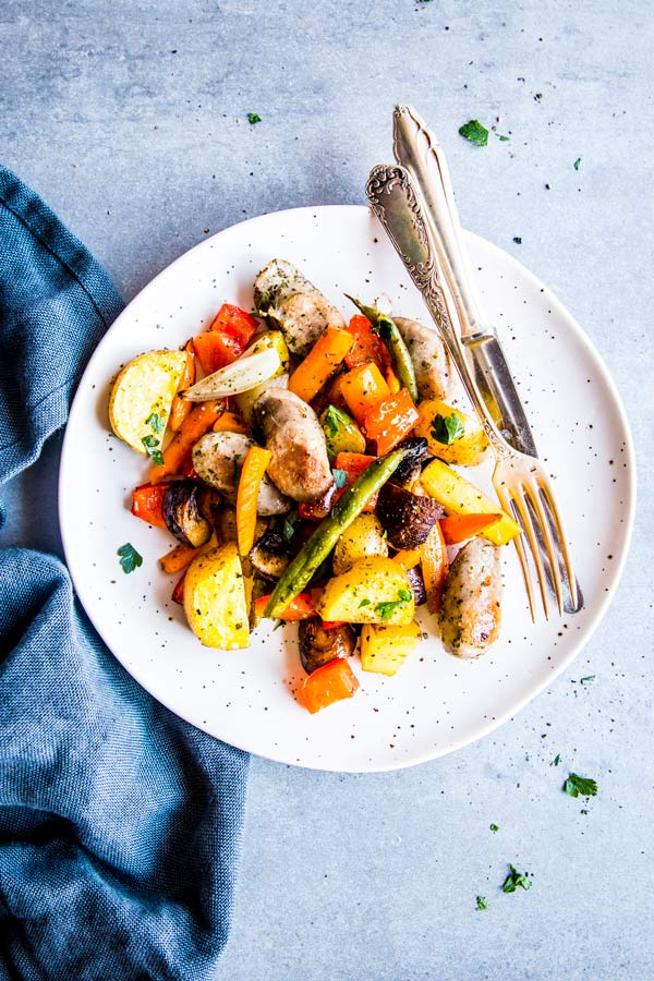 sausage potato and vegetables sheet pan dinner on a plate