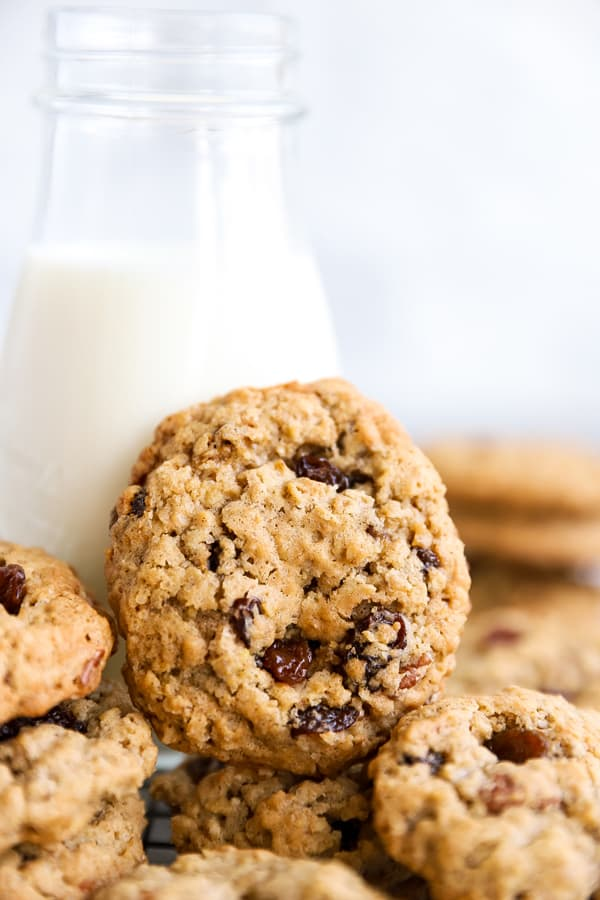 oatmeal raisin cookie leaning against a bottle of milk