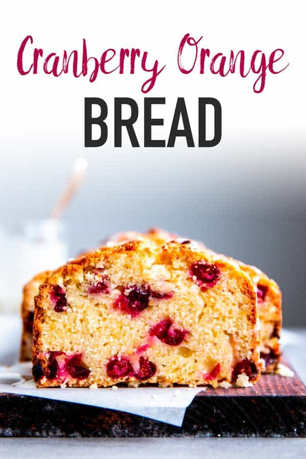cranberry orange bread on a wooden board with text around it