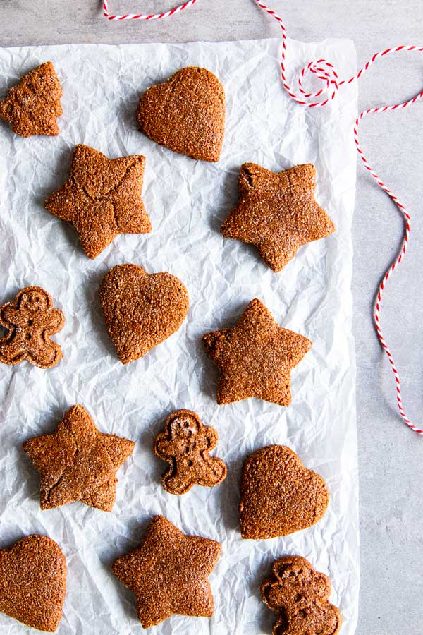 freshly baked gingerbread cookies on parchment