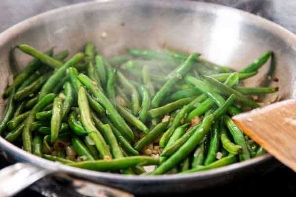 sauteed green beans in a skillet
