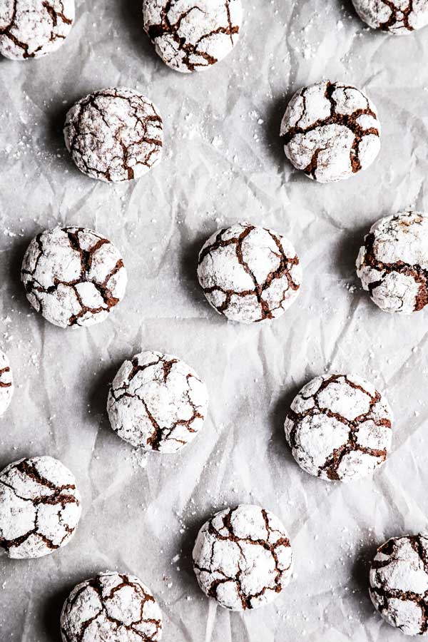 chocolate crinkle cookies on a piece of parchment