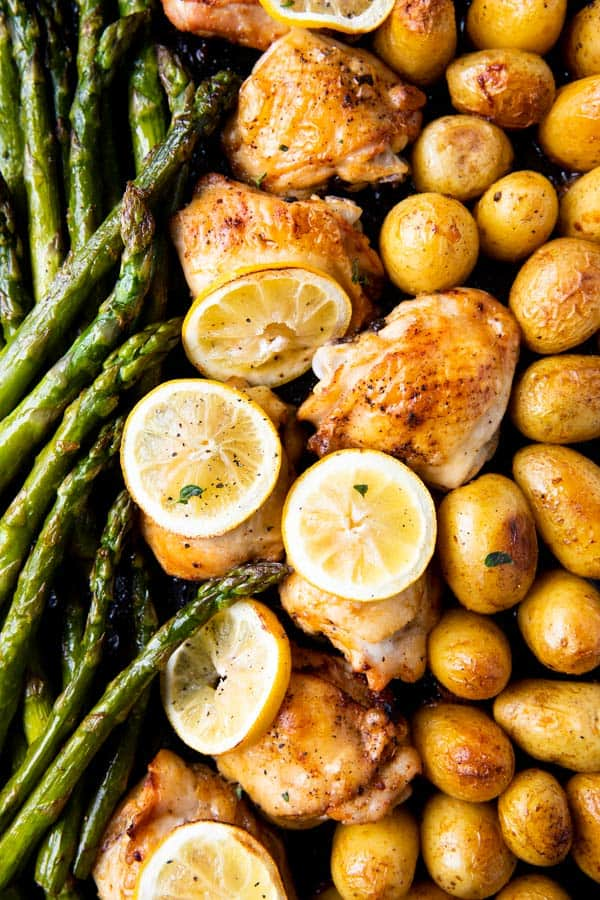 close up photo of a chicken and asparagus sheet pan dinner