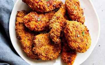 plate with pieces of cornmeal oven fried chicken
